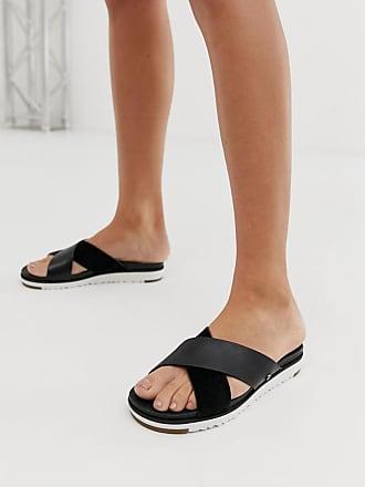 UGG Kari - Schwarze Sandalen mit überkreuzten Riemen