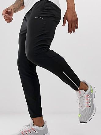 3e815bc88235d Asos Pantalon de jogging tissé coupe ajustée et fuselée avec fermeture  éclair réfléchissante - Noir -
