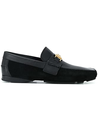 6749a94aa Versace embellished Medusa loafers - Black