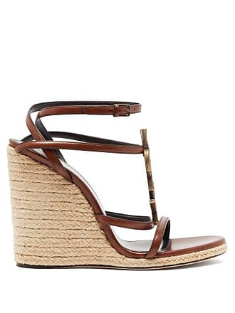 cb85108a7b8 Saint Laurent Cassandra Ysl Monogram Leather Wedge Sandals - Womens - Tan