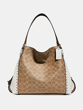 b4aff22c6642 Coach Coach Edie Shoulder Bag 31 In Signature Canvas With Rivets