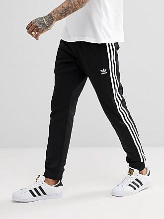 e656c2cb38 adidas Originals Superstar - Pantalon de jogging ajusté à chevilles  resserrées - Noir cw1275 - Noir