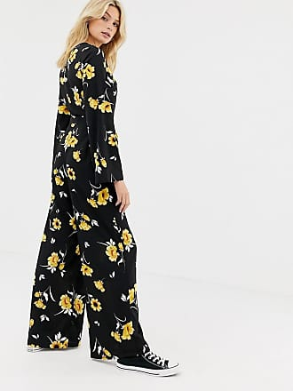 fe4780ace306 Influence Tall flared sleeve button detail wide leg jumpsuit in floral print  - Black