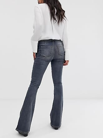 5c80146f5543f Asos Maternity ASOS DESIGN Maternity super low rise flare jeans in dark  stone wash blue with
