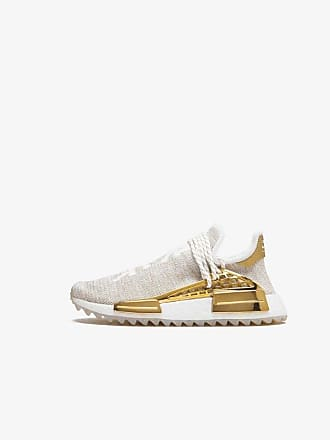 adidas Gold and White Adidas X Pharrell Williams Hu Holi NMD sneakers
