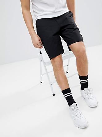 025b73a36e551 Religion Pantalones cortos de skater en negro con el borde sin rematar de  Religion