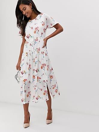 55c554a134bc Klänning Dam. Frakt: gratis. Fashion Union Blommig midiklänning med  nedsläppt fåll - Occasion floral