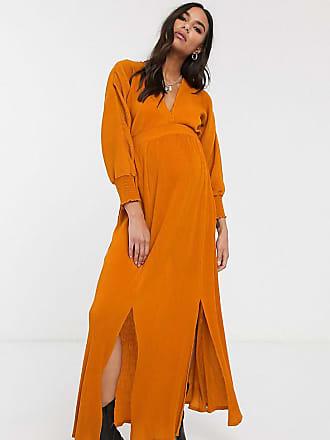 Asos Maternity ASOS DESIGN Maternity long sleeve shirred waist maxi dress in rib in orange-Multi