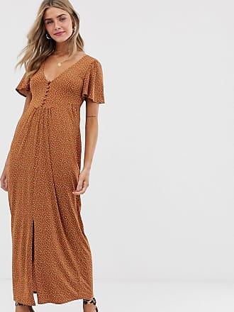 0e1d7bbe5 Asos Vestido de tarde largo en punto de crepé marrón con estampado de  lunares y botones