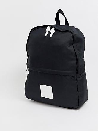 aea9d3a0cbf Asos Svart ryggsäck med vit PU-etikett med logga - Svart