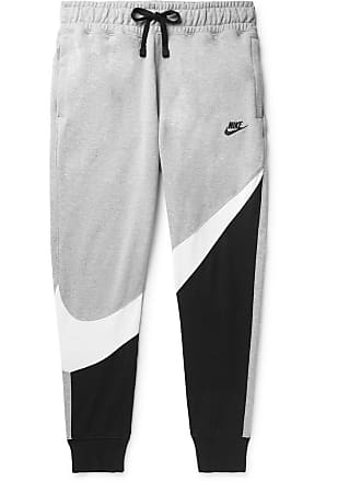 06298d3d6 Nike Slim-fit Tapered Logo-print Loopback Cotton-blend Jersey Sweatpants -  Gray