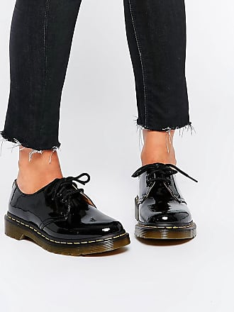 ffbf00b794b Dr. Martens Zapatos planos clásicos de charol negro 1461 de Dr Martens