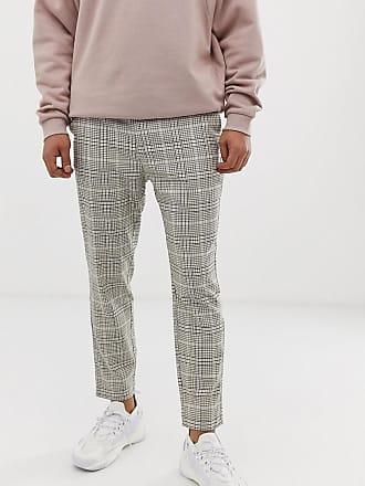 c0dd680354c Bershka skinny pants with houndstooth print in beige - Beige
