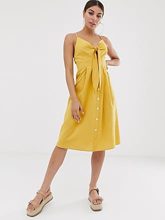 c9516dedf1fd Missguided Vestito midi allacciato sul davanti giallo con bottoni - Giallo