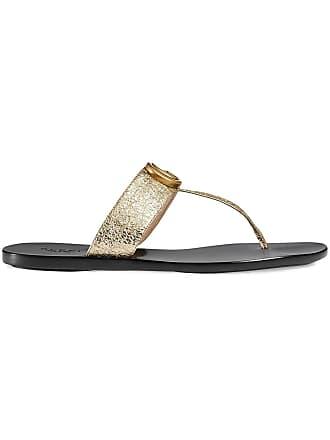 fc53b7654736 Gucci gold double G leather thong sandal. - Metallic