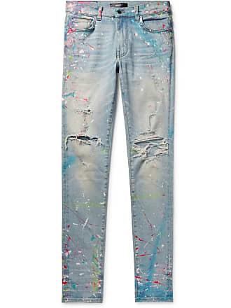 c48fb9ffe0154b Amiri Skinny-fit Distressed Paint-splattered Stretch-denim Jeans - Light  denim