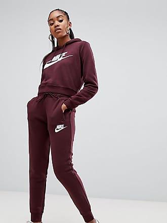 Nike Rally - Vinröda sweatpants med logga och lössittande passform - Röd bf197089d8173