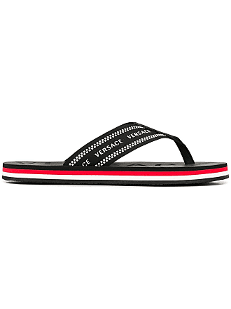 98d480abfe2b9 Versace logo print flip flops - Black