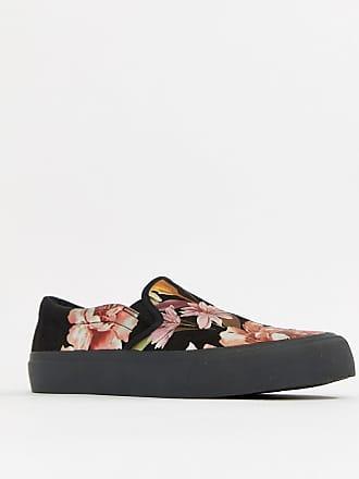 0b34f93ccf6 Asos Wide Fit slip on plimsolls in black with floral print - Black