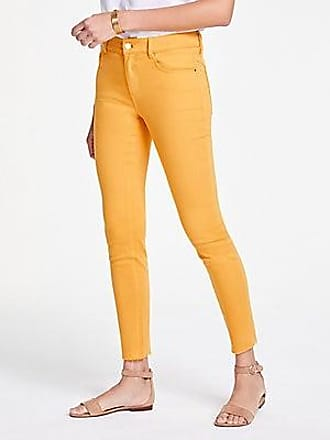 9d830f3ea3 Petite Performance Stretch Skinny Jeans in Bright Mid Indigo Wash.  Delivery: free. ANN TAYLOR Performance Stretch Cut Hem Skinny Jeans in Wild  Pollen