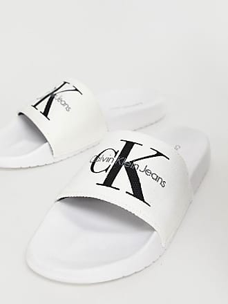 0adea8412d8 Calvin Klein Chantal white canvas sliders