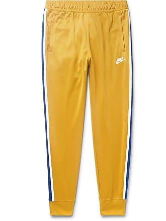 3fadc9de8957 Nike Sportswear Tapered Webbing-trimmed Tech-jersey Track Pants - Saffron