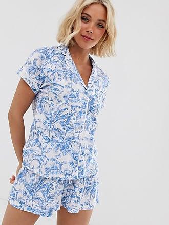 a446ae618e625b Women'secret Pijama blanco y azul de manga corta on solapas y estampado de  selva