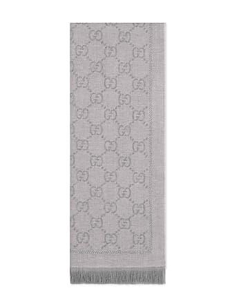 5baf8e3a0f82c Gucci Schal aus Strick mit GG Jacquard Muster