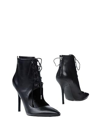 11bec49aa1 Guess® : Chaussures en Noir jusqu''à −47% | Stylight
