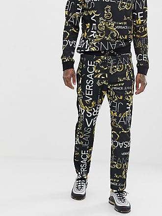 b31f2e53ae3 Versace Jeans Couture Pantalon de jogging ajusté avec logo imprimé sur  lensemble - Noir