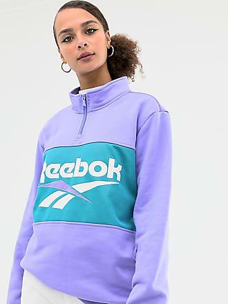 ec2bc13129d Reebok Sudadera con media cremallera y logo de vector en violeta de Reebok  Classics