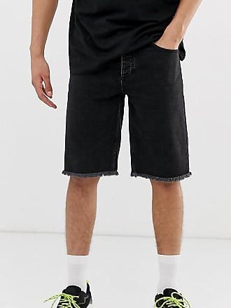 Reclaimed Vintage inspired denim shorts with raw hem in black