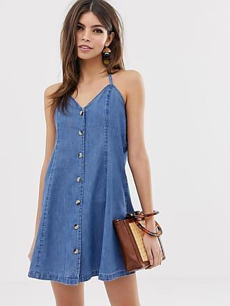 Asos Denim - Vestitino di jeans allacciato al collo con bottoni blu  lavaggio medio - Blu a9cb582c863