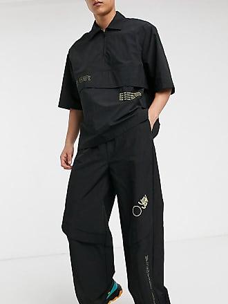 Collusion Jogginghose aus Nylon mit Plastisol-Print in Schwarz