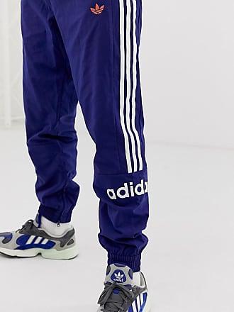 02c1e62df91 adidas Originals Pantalon de jogging tissé à 3 bandes - Bleu marine FH7903  - Navy