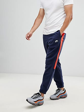 timeless design abc9b 8afa2 Nike Borg - Pantalon de jogging avec bande sur le côté - Bleu marine 929126-