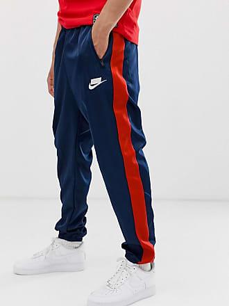 e0feaffb2b Nike Pantalon de jogging à logo avec rayure sur le côté - Bleu marine - Navy