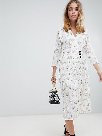 63554abfea26 Asos Petite ASOS DESIGN Petite pleated maxi dress with side buttons in  ditsy floral - Multi
