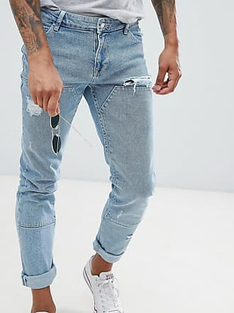 d509d4019164 Asos skinny jeans in light wash blue cut and sew panelling - Blue