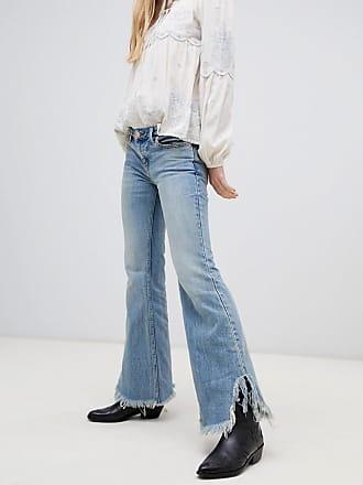 Free People Vintage - Utsvängda jeans med råskuren kant - Blå 834963ce85b58