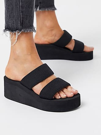 Truffle glam heeled mules in black