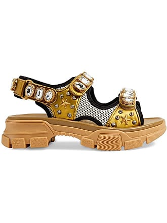 3b8a703e9e0 Gucci Metallic leather sandal with crystals - Gold