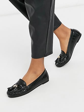 Truffle flat tassel loafers in black croc
