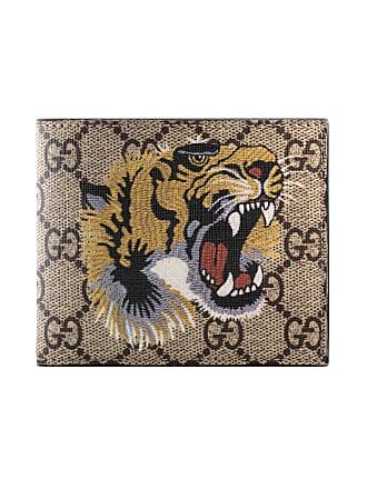 Gucci Portafoglio in tessuto GG Supreme con stampa tigre 2478c944c9d