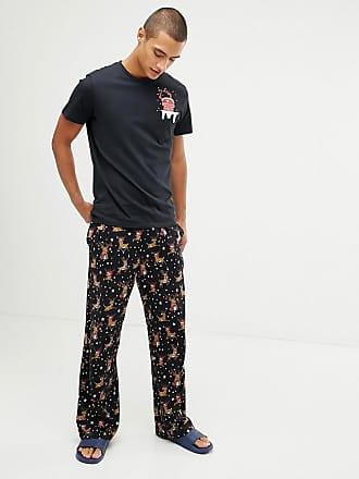 Asos Holidays straight leg pyjama bottoms in leaping reindeer print in organic cotton - Black