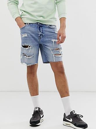 315f7d630960 Pantaloncini di jeans neri con abrasioni - Nero. Spedizione: gratuita. Bershka  Pantaloncini di jeans slim strappati azzurri - Blu