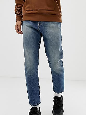 Collusion x003 - Schmal zulaufende Jeans in dunkler Stone-Waschung-Beige