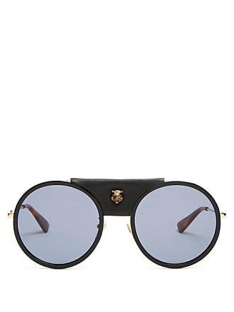 914daefc1536a Gucci Lunettes de soleil rondes en métal finitions cuir