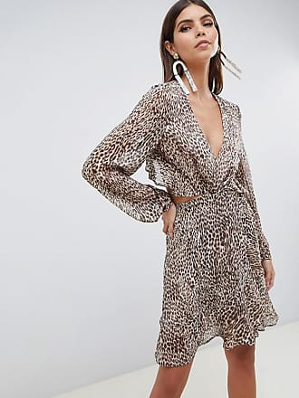 38eaf1355c5f Asos long sleeve mini dress with open back in Animal print with ruffle  details