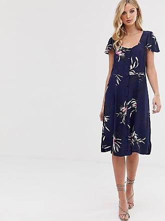 05645ad642f0 Vero Moda Blommig klänning med knappar - Marinblå